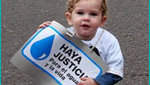 World_water_week_child_with_poster