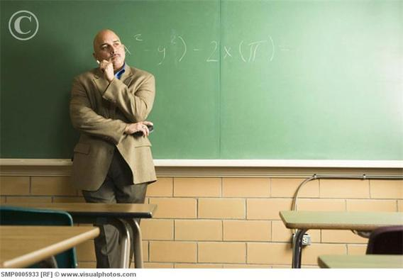 Professor_leaning_on_chalkboard_smp0005933