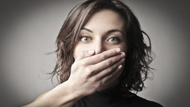 Woman_covering_mouth