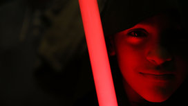 Child_holding_lightsaber