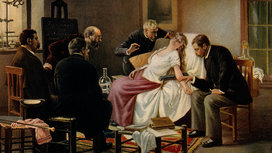 A_female_patient_being_hypnotised_in_front_of_a_group_of_fou_wellcome_v0016621