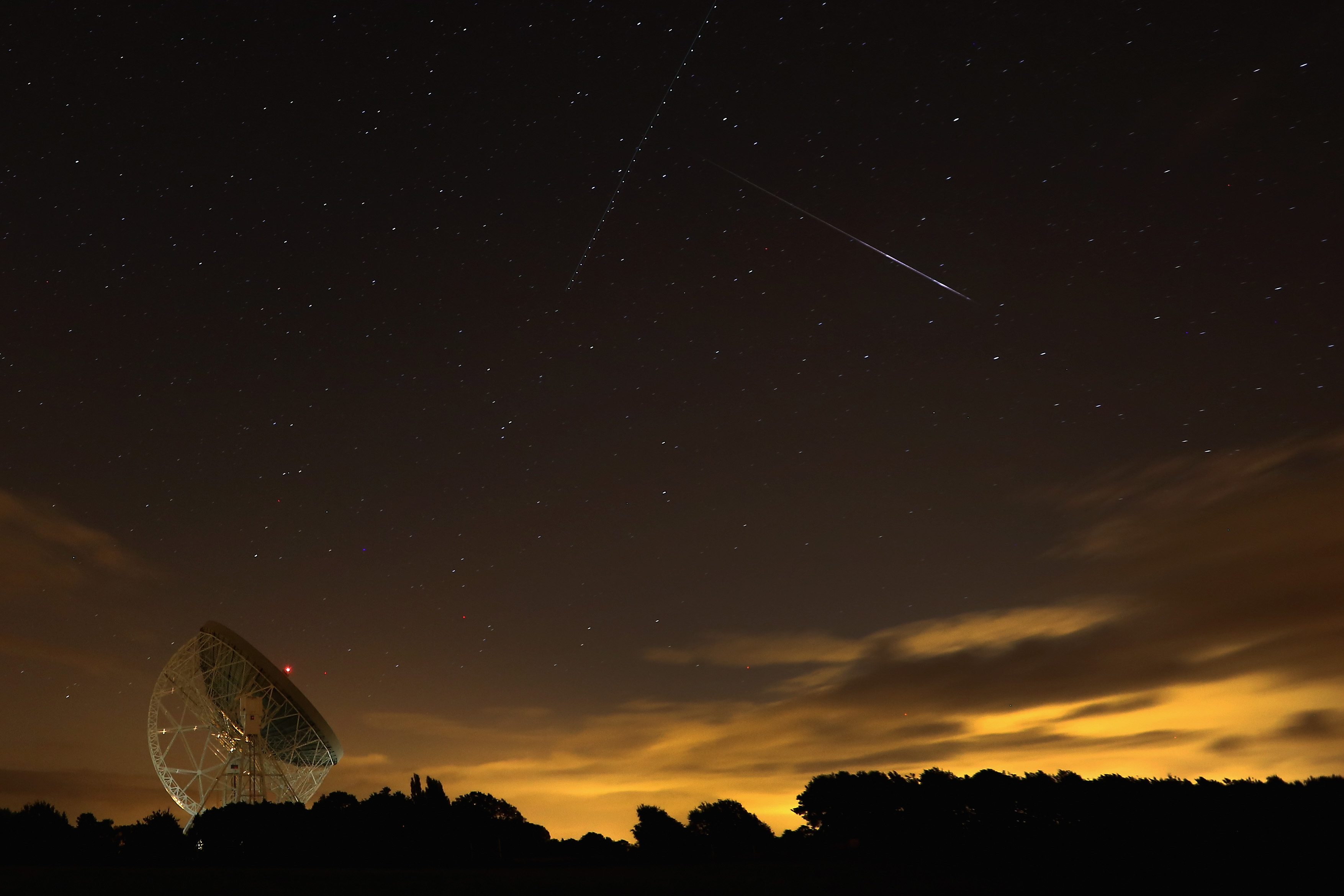 A Perseid meteor streaks across the sky over the Lovell Radio Telescope at Jodrell Bank on August 13, 2013 in Holmes Chapel, United Kingdom. (Photo by Christopher Furlong/Getty Images)
