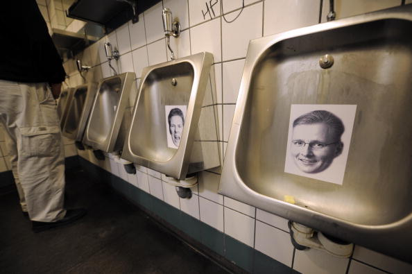 Urinals in a Reykjavik bar display the faces of bankers responsible for the financial crisis. (OLIVIER MORIN/AFP/Getty Images)