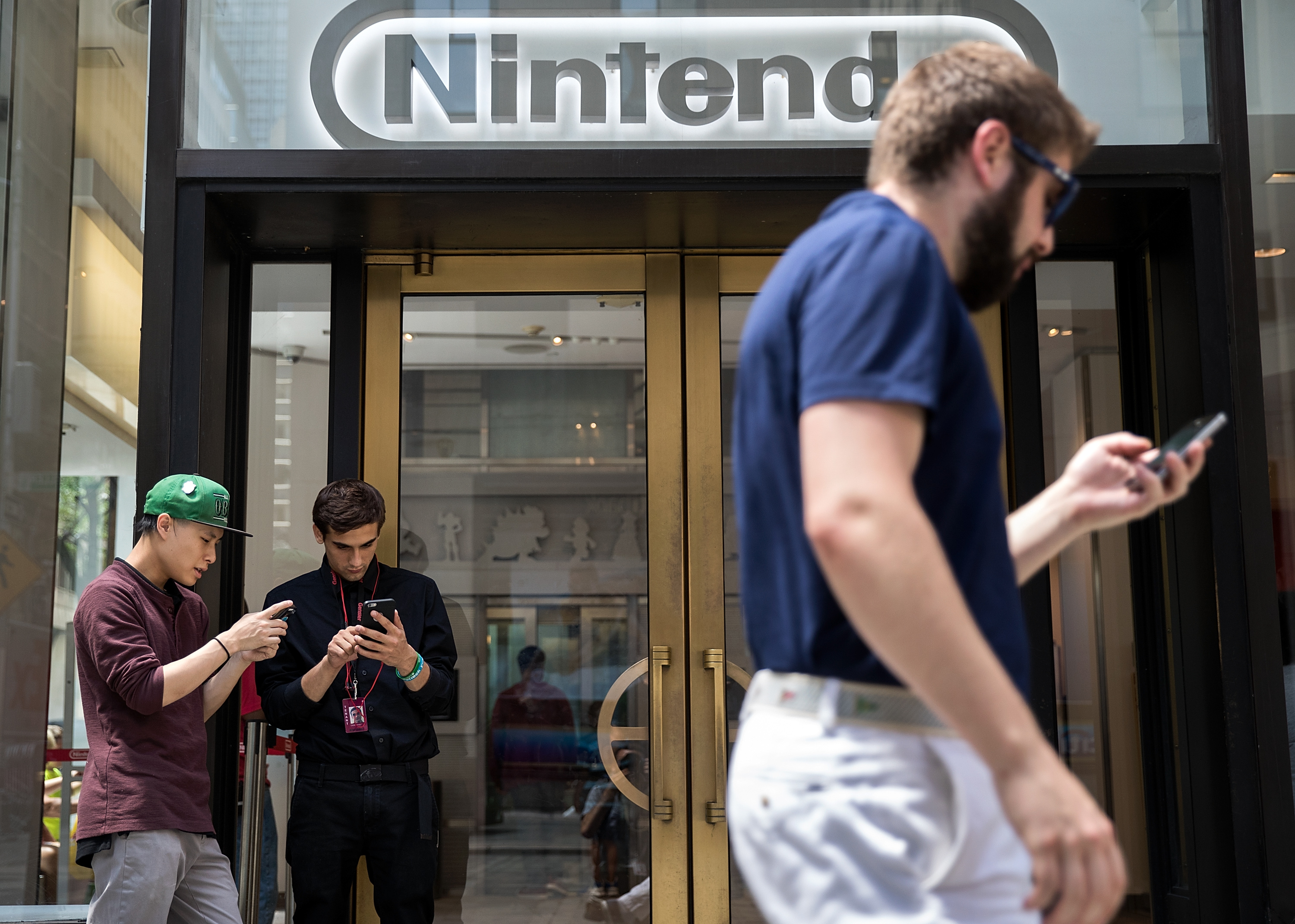 players outside a Nintendo store