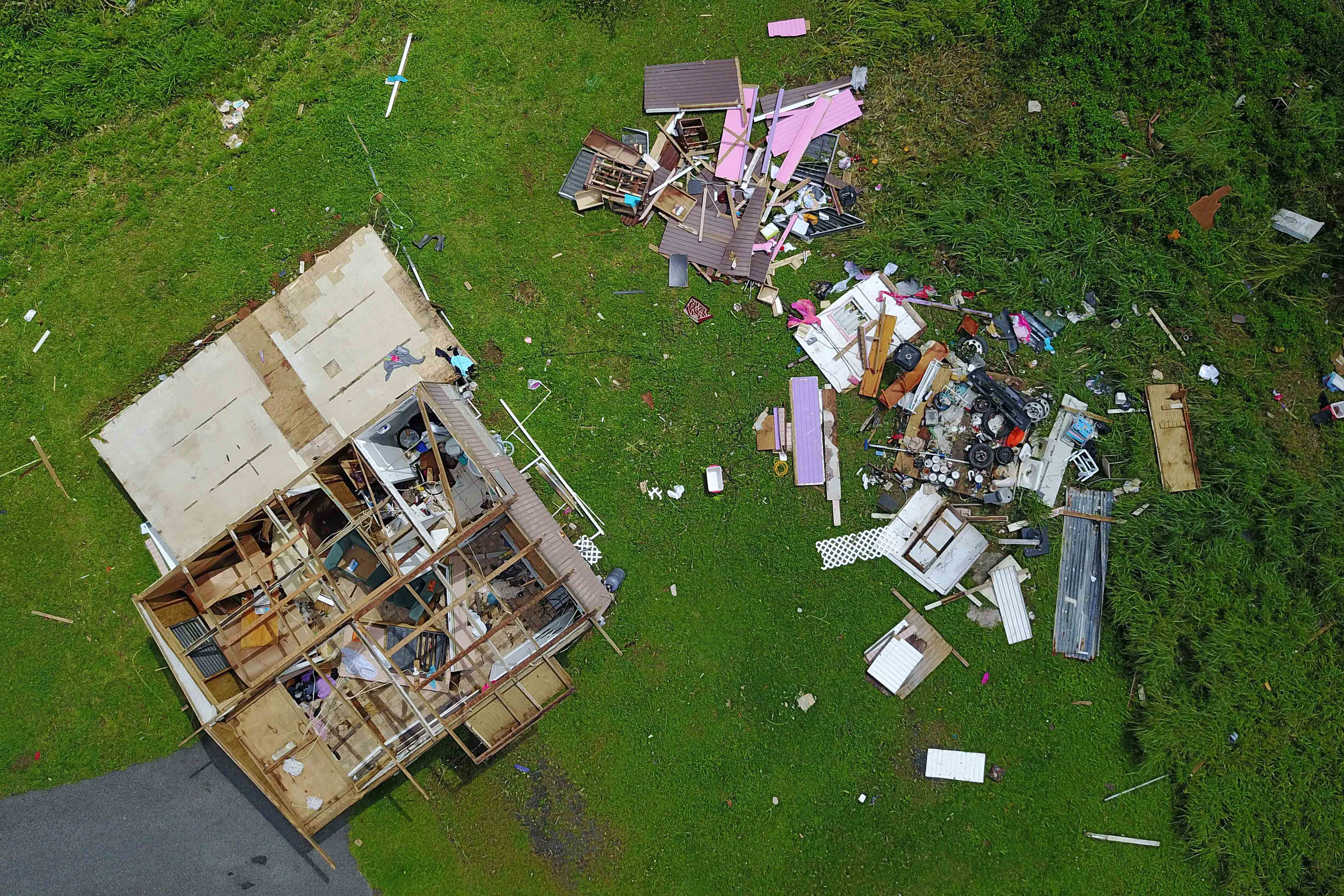 A house destroyed by hurricane winds is seen in Barranquitas, southwest of San Juan, Puerto Rico.