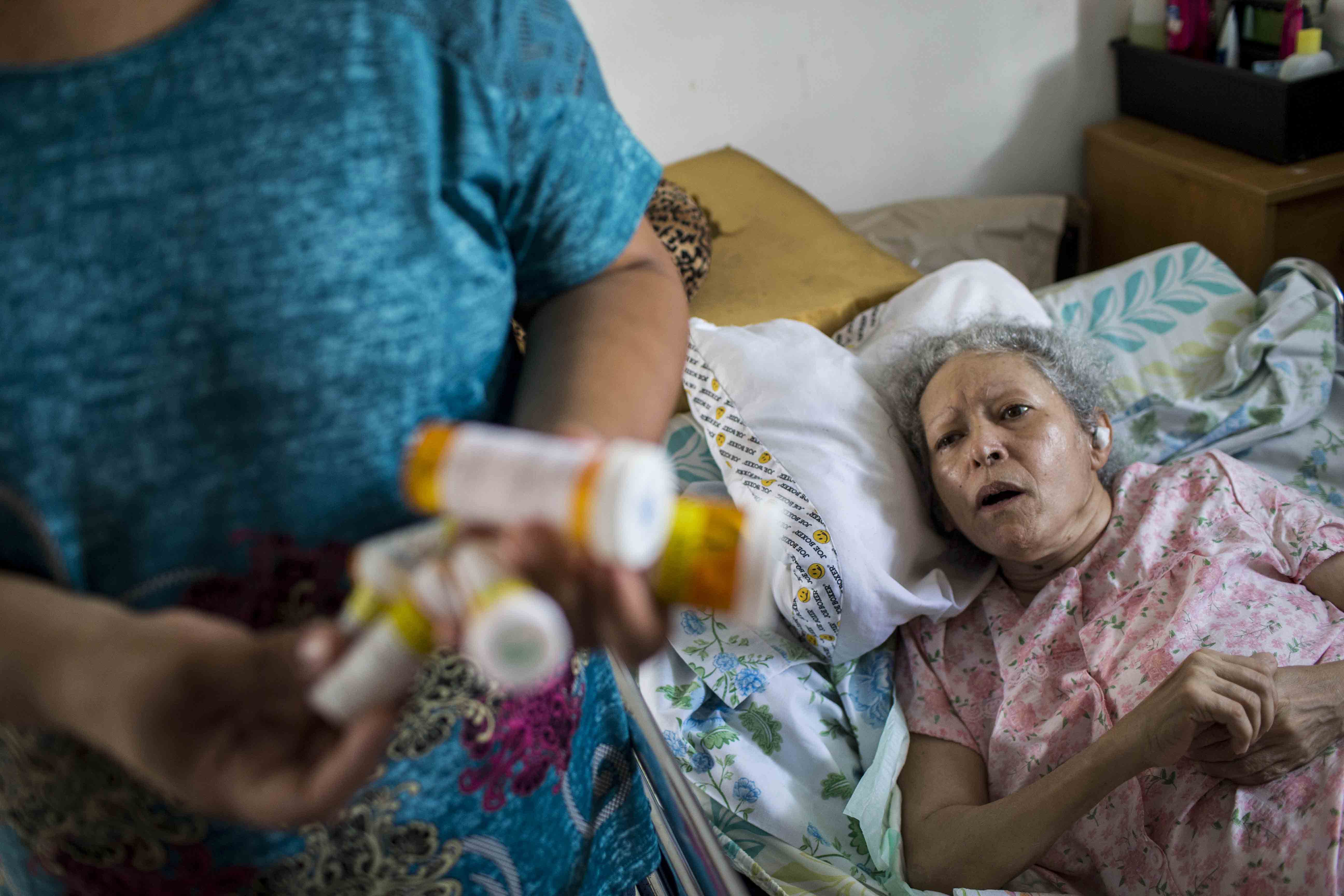 JUNCOS PUERTO RICO SEPTEMBER 24: Marry Ann Aldea holds her mother Maria Dolores Hernandez medicines at her home.