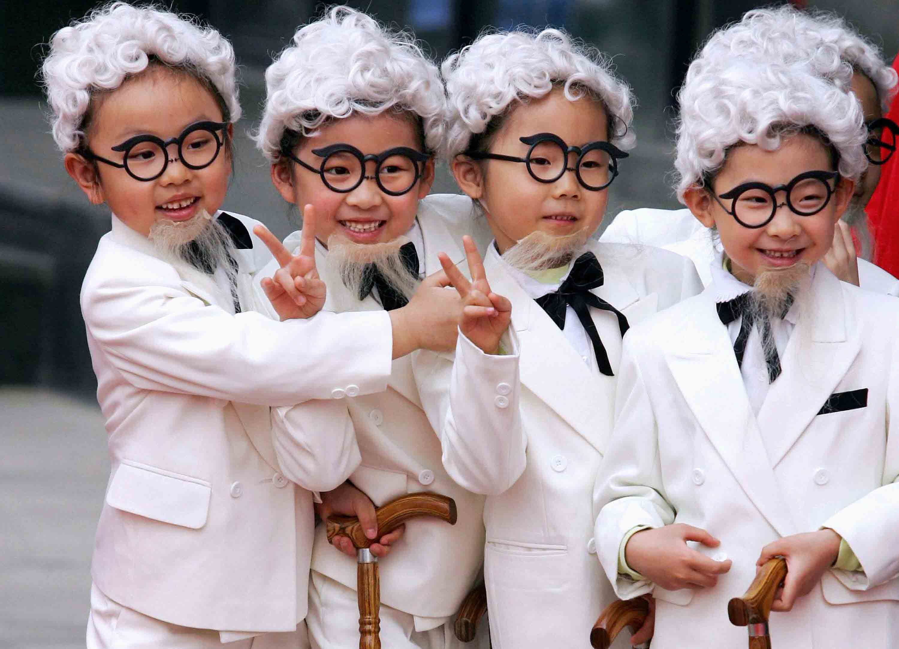 Chinese children dress up as KFC mascot Colonel Sanders