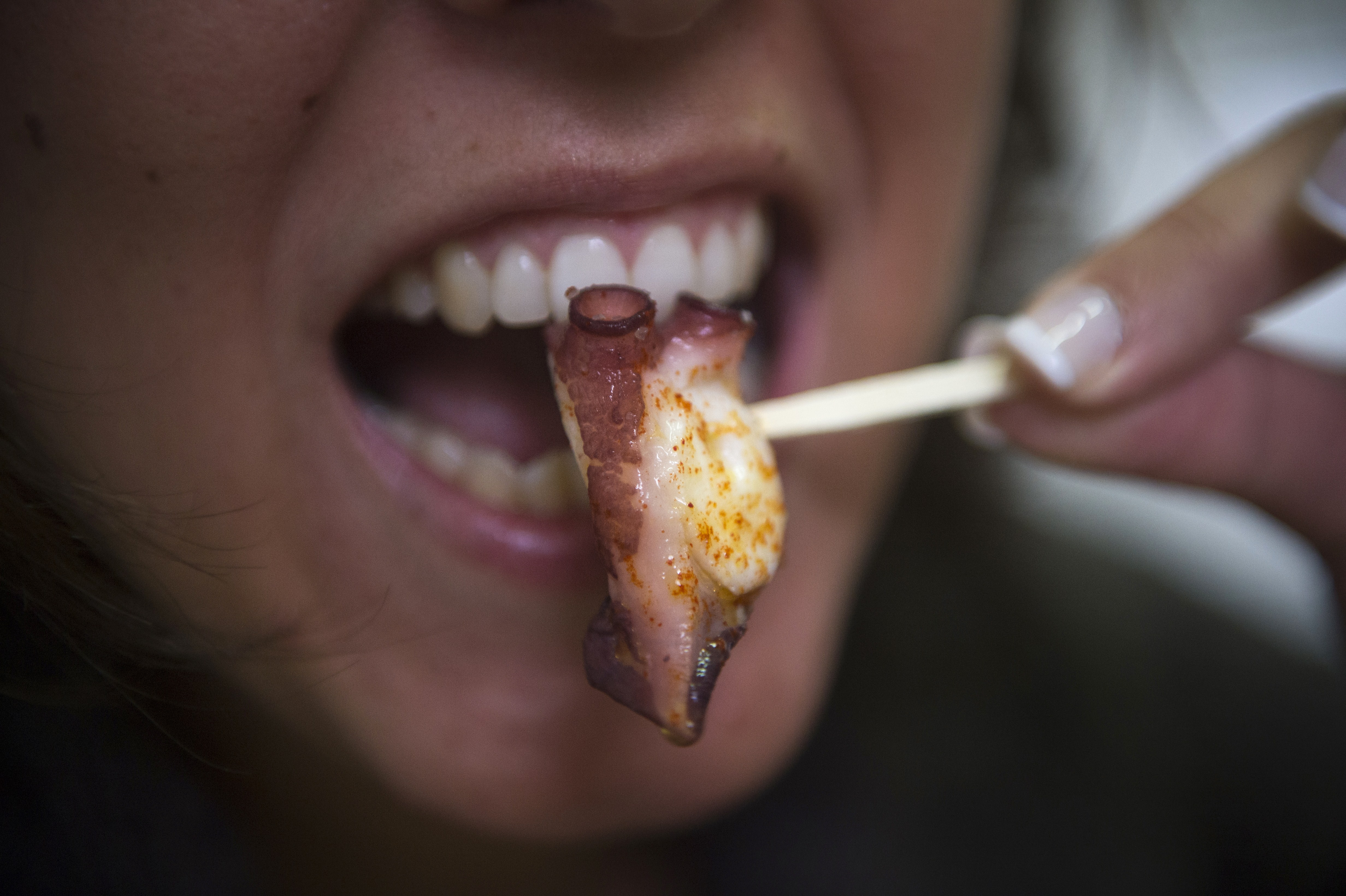 A customer eats a 'pulpo a feira' (meaning fair-style octopus in Galician), a boiled octopus dish, at the restaurant Ultreya in Palas de Rei, northern Spain on November 22, 2014. (Photo credit GEORGE SHELTON/AFP/Getty Images)