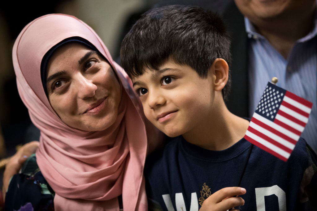 New immigrants to America at citizenship ceremony